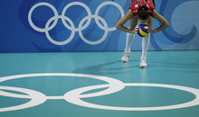 USA's Logan Tom kisses the ball before serving against Venezuela at the Beijing 2008 Olympics. The Utah native and Highland High grad is gearing up for her fourth Olympics in London next month. (AP Photo/Andy Wong)