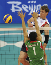 Ryan Millar spikes the ball for the USA men's volleyball team during the Beijing 2008 Olympics. Millar, a former BYU Cougar, is gearing up for his fourth Olympics in London next month. (AP Photo/Andy Wong)
