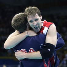 Ryan Millar celebrates with a teammate after winning their men's volleyball semifinal match against Russia at the Beijing 2008 Olympics. Millar, a former BYU Cougar, is gearing up for his fourth Olympics in London next month. (AP Photo/Andy Wong)