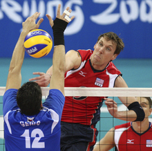 Ryan Millar of United State men's volleyball team spikes against Serbia during the Beijing 2008 Olympics. The former BYU Cougar is gearing up for his fourth Olympics next month in London. (AP Photo/Koji Sasahara)