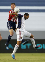 Chivas USA defender Danny Califf, left, battles Real Salt Lake forward Alvaro Saborio, of Costa Rica, for the ball during the first half of an MLS soccer match in Carson, Calif., Saturday, June 16, 2012. (AP Photo/Alex Gallardo)