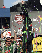 Bob Brodbeck | The Associated Press Dale Earnhardt Jr. celebrates after winning the NASCAR Sprint Cup Series Quicken Loans 400 auto race at Michigan International Speedway, Sunday, June 17, 2012, in Brooklyn, Mich. (AP Photo/Bob Brodbeck)