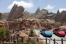 This June 5, 2012 photo shows riders on the new Car Land attraction at Disney California Adventure in Anaheim, Calif. The park's five-year, $1 billion-plus revamp has debuted in spurts since 2008. Most of its new features rely on characters that come from Disney's $7.4 billion acquisition of Pixar Animation Studios, the San Francisco-area studio behind