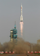 In this photo released by China's Xinhua News Agency, the Long March-2F carrier rocket carrying China's manned Shenzhou-9 spacecraft blasts off from the launch pad at the Jiuquan Satellite Launch Center in Jiuquan, northwest China's Gansu Province, Saturday, June 16, 2012. (AP Photo/Xinhua, Wang Jianmin) NO SALES)