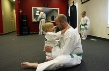 Kim Raff | The Salt Lake Tribune Dov Siporin hugs his daughter, Siena, while warming up for a lesson at Salt Lake Valley Tae Kwon Do Academy in Salt Lake City. Dov takes lessons with his kids when he is feeling well enough.
