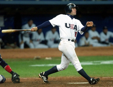 Doug Mientkiewicz watches the beginning of his 8th inning grand slam during the team's preliminary game against Korea at the Sydney Olympic Park Baseball Stadium in Sydney, Wednesday, Sept. 20, 2000.  USA won 4-0. (AP Photo/Eric Gay)