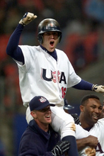 Doug Mientkiewicz of the United States is hoisted by his teammates after his solo home run in the ninth inning beat Korea 3-2 in the semifinals of the Olympic baseball competition Tuesday, Sept. 26, 2000, in Sydney. (AP Photo/Eric Gay)
