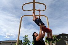 Anne Eliason helps her son Isaac, 5, play at a neighborhood park in Highlands Ranch, Colo., on Monday, June 4, 2012. Isaac has been diagnosed with autism and his family moved from Utah to Colorado because of the insurance options and superior therapeutic and support services for Isaac. Isaac has appointments nearly everyday to work on speech, occupational and behavioral therapy. Photo by Chris Schneider