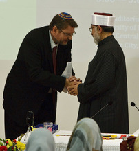 Leah Hogsten  |  The Salt Lake Tribune Alan Bachman, chairman of the Salt Lake Interfaith Roundtable welcomes Dr. Muhammad Tahir ul Qadri (right). Muslim scholar Dr. Muhammad Tahir ul Qadri, a Pakistani cleric who issued a 2010 fatwa condemning terrorism and suicide bombings as contrary to Islamic law delivers his lecture