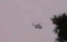 This image made from amateur video released by the Shaam News Network and accessed Saturday, June 16, 2012, purports to show a Syrian military helicopter firing over a village in Daraa, Syria. The Syrian government, intent on wresting back control of rebel-held areas, launched a fierce offensive in recent days to recover territories in several locations, shelling heavily populated districts and using attack helicopters over towns and cities. (AP Photo/Shaam News Network via AP video) TV OUT, THE ASSOCIATED PRESS CANNOT INDEPENDENTLY VERIFY THE CONTENT, DATE, LOCATION OR AUTHENTICITY OF THIS MATERIAL