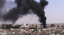 This image made from amateur video provided by the Shaam News Network and accessed Monday, June 18, 2012, purports to show black smoke rising from buildings in Homs, Syria. Syrian forces renewed shelling of the central city of Homs on Monday, one day after the head of the U.N. observers' mission demanded that warring parties allow the evacuation of women, children, elderly and sick people, activists said. (AP Photo/Shaam News Network via AP video) TV OUT, THE ASSOCIATED PRESS CANNOT INDEPENDENTLY VERIFY THE CONTENT, DATE, LOCATION OR AUTHENTICITY OF THIS MATERIAL