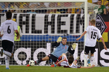 Germany's Lars Bender, right, scores his side's second goal during the Euro 2012 soccer championship Group B  match between Denmark and Germany in Lviv, Ukraine, Sunday, June 17, 2012. (AP Photo/Martin Meissner)