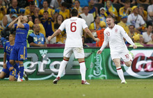 England's Wayne Rooney, right, celebrates after scoring a goal   during the Euro 2012 soccer championship Group D match between England and Ukraine in Donetsk, Ukraine, Tuesday, June 19, 2012. (AP Photo/Matthias Schrader)