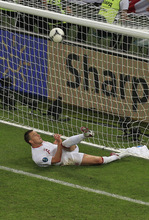 England's John Terry clears a ball that went over the line during the Euro 2012 soccer championship Group D match between England and Ukraine in Donetsk, Ukraine, Tuesday, June 19, 2012. (AP Photo/Vadim Ghirda)