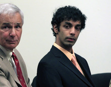 FILE - In this May 30, 2012, file photo, Dharun Ravi, right, sits with his attorney Joseph Benedict during a hearing in New Brunswick, N.J. Ravi, the former Rutgers University student convicted of using his webcam to watch his roommate kiss another man, is due to be released from jail Tuesday, June 19 after serving 20 days of a 30 day sentence. Ravi reported to jail last month even though he could have remained free during an appeal of the case. (AP Photo/Mel Evans, File)