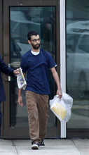 Dharun Ravi, 20, walks out of Middlesex County jail in North Brunswick, N.J., Tuesday, June 19, 2012. The Indian-born former Rutgers University student who was convicted of bias intimidation for using a webcam to see his roommate kissing another man was released from jail Tuesday after serving 20 days of a 30-day sentence. (AP Photo/Mel Evans)