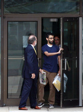 Dharun Ravi, 20, right, walks out of Middlesex County jail with his attorney Steven Altman, in North Brunswick, N.J., Tuesday, June 19, 2012. The Indian-born former Rutgers University student who was convicted of bias intimidation for using a webcam to see his roommate kissing another man was released from jail Tuesday after serving 20 days of a 30-day sentence. (AP Photo/Mel Evans)