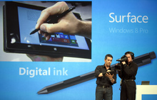 Mike Angiulo, Corporate Vice President, Windows Planning, Hardware & PC Ecosystem for Microsoft, left, demonstrates the Digital Ink feature of
