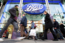 FILE -  In an Oct. 5, 2005 file photo people walk by a Boots pharmacy in central London.    Drugstore chain Walgreen Co. says it will spend $6.7 billion to buy a stake in health and beauty retailer Alliance Boots.    (AP Photo/Sergio Dionisio)