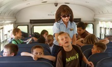 Trent Nelson  |  The Salt Lake Tribune School bus driver Sylvia Wouters with students from Pleasant Green Elementary School Friday, June 15, 2012 in Magna, Utah. Granite School District has installed video cameras on school buses.