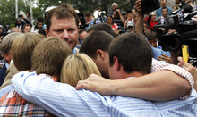 Former Major League Baseball pitcher Roger Clemens, left center, is surrounded by his family members outside federal court, Monday, June 18, 2012 in Washington after his acquittal on charges of lying to Congress in 2008 when he denied ever using performance-enhancing drugs. (AP Photo/Alex Brandon)