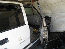 Where a DUI suspect's drive ended: crashed into the closed garage door of his own home. (Provo Police photo)
