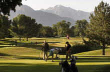 Al Hartmann  |  The Salt Lake Tribune  A trio of golfers finish up on the ninth hole during an early morning round on a cool morning Tuesday, June 19 at Forrest Dale Golf Course  in Salt Lake City.
