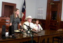 Heather McMinn, district attorney for Guadalupe, Gonzales and Lavaca Counties, speaks at a news conference with Lavaca County Sheriff Micah Harmon, second from right, and V'anne Huger, right, attorney for the father, at a news conference on a Texas father who beat to death a man who tried molesting his 5-year-old daughter Tuesday, June 19, 2012, in Halletttesville, Texas. Officials said the Lavaca County grand jury met Tuesday and declined to return an indictment against the father in the death of 47-year-old Jesus Mora Flores. (AP Photo/Ramit Masti)