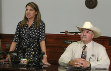 25th Judicial District Attorney Heather McMinn, left, and Lavaca County Sheriff Mica Harmon appear at a news conference in Halletsville, Texas on Tuesday, June 19, 2012 to announce that a grand jury declined to return an indictment against a young father who beat to death Jesus Mora Flores for molesting the man's five-year-old daughter. (AP Photo/San Antonio Express-News, Kin Man Hui)