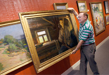 Francisco Kjolseth  |  The Salt Lake Tribune (File photo) Jim Dabakis, an art dealer specializing in Russian Impressionist art, moves a piece titled