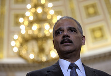 Attorney General Eric holder speaks to reporters following his meeting on Capitol Hill in Washington, Tuesday, June 19, 2012. Holder wants a House panel to drop plans to try to hold him in contempt of Congress, and the panel's chairman wants more Justice Department documents regarding Operation Fast and Furious, a flawed gun-smuggling probe in Arizona. Holder and Rep. Darrell Issa, a California Republican, met in an effort to resolve their dispute over the investigation of Fast and Furious by the House Oversight and Government Reform Committee that Issa chairs. (AP Photo/Susan Walsh)