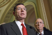 FILE - In this Feb. 14, 2012, file photo, Sen. John Barrasso, R-Wyo., left, accompanied by Senate Minority Leader Mitch McConnell of Ky., speaks with reporters on Capitol Hill in Washington. Congressional Republicans intend to seek quick repeal of any parts of the health care law that survive a widely anticipated Supreme Court ruling, but don't plan to push replacement measures until after the fall elections or perhaps 2013.   (AP Photo/J. Scott Applewhite, File)
