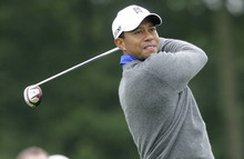 Tiger Woods watches his tee shot on the first hole during the second round of the Memorial golf tournament Friday, June 1, 2012, in Dublin, Ohio. Woods birdied the hole. (AP Photo/Jay LaPrete)