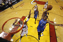 Oklahoma City Thunder point guard Russell Westbrook (0) dunks against the Miami Heat during the first half at Game 4 of the NBA Finals basketball series, Tuesday, June 19, 2012, in Miami.  (AP Photo/Mike Segar, Pool)