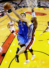 Oklahoma City Thunder power forward Nick Collison (4) shoots against Miami Heat power forward Chris Bosh (1) during the first half at Game 4 of the NBA Finals basketball series, Tuesday, June 19, 2012, in Miami.  (AP Photo/ Larry W. Smith, Pool)