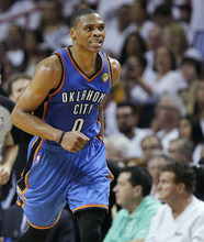 Oklahoma City Thunder point guard Russell Westbrook heads down the floor against the Miami Heat during the first half at Game 4 of the NBA finals basketball series, Tuesday, June 19, 2012, in Miami.  (AP Photo/Lynne Sladky)