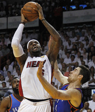 Miami Heat small forward LeBron James (6) shoots against Oklahoma City Thunder power forward Nick Collison (4) during the first half of Game 4 of the NBA Finals basketball series, Tuesday, June 19, 2012, in Miami.  (AP Photo/Lynne Sladky)