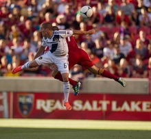 Trent Nelson  |  The Salt Lake Tribune L.A.'s Bryan Jordan and RSL's Chris Wingert leap for the ball as Real Salt Lake hosts the L.A. Galaxy at Rio Tinto Stadium on Wednesday, June 20, 2012, in Sandy.