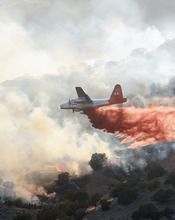 An air tanker drops fire retardant on the GlenAnna blaze in southcentral Utah. (Kreig Rasmussen/Interagency Fire Center)