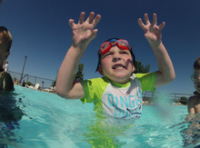 Francisco Kjolseth  |  The Salt Lake Tribune Joshua Kubinak, 5, shows off his