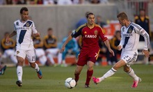 Trent Nelson  |  The Salt Lake Tribune David Beckham kicks the ball, with RSL's Fabian Espindola, center, and L.A.'s Juninho at left, as Real Salt Lake hosts the L.A. Galaxy at Rio Tinto Stadium on Wednesday, June 20, 2012, in Sandy.