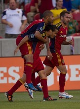 Trent Nelson  |  The Salt Lake Tribune RSL's Fabian Espindola carries teammate Alvaro Sabori, celebrating Saborio's first-half goal Wednesday night.