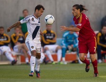 Trent Nelson     The Salt Lake Tribune RSL's Fabian Espindola, right, and L.A.'s Juninho go for the ball as Real Salt Lake hosts the L.A. Galaxy at Rio Tinto Stadium on Wednesday, June 20, 2012, in Sandy.