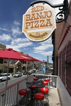 Al Hartmann  |  The Salt Lake Tribune  The Red Banjo Pizza Parlour's upstari patio has one of the best views over Park City's Main Street. The restaurant's 50th birthday celebration will take place Sunday.