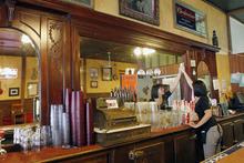 Al Hartmann  |  The Salt Lake Tribune Server Jessica Hanson tends to the venerable bar at the Red Banjo Pizza Parlour.