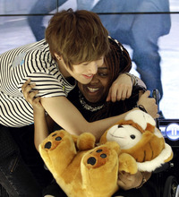 Donika Sterling from New York, right, gets a hug from Tae Min, her most favorite member of South Korean pop group SHINee after their meeting in Seoul, South Korea, Wednesday, June 20, 2012. The 15 year-old American K-pop fan, who is suffering a disease that gradually causes loss of muscle tissue and slows down parts of the body, met and sang with the boy band she idolizes. (AP Photo/Lee Jin-man)