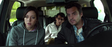 This undated film image released by FilmDistrict shows Aubrey Plaza, left, Karan Soni and Jake Johnson, right, in a scene from