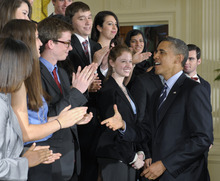 President Barack Obama greets students after he called on Congress to stop interest rates on student loans from doubling next month during a news conference in the East Room of the White House in Washington, Thursday, June 21, 2012. (AP Photo/Susan Walsh)
