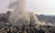 This citizen journalism image provided by Shaam News Network SNN and taken on Thursday, June 21, 2012, purports to show smoke from shelling rising up from buildings in the Khaldiyeh neighborhood of Homs province, central Syria. (AP Photo/Shaam News Network, SNN)THE ASSOCIATED PRESS IS UNABLE TO INDEPENDENTLY VERIFY THE AUTHENTICITY, CONTENT, LOCATION OR DATE OF THIS HANDOUT PHOTO