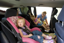 Paul Fraughton  |  The Salt Lake Tribune Lisel Christiansen packs her van Friday, June 22, 2012, as she prepares to leave her home in Eagle Mountain. Her children Ellie, age 4, and Luci, 2, front, along with their sister Madelyn, 9, and Lisel's mother, Carol Grimaud, piled into the family van and left the neighborhood that was ordered to evacuate as a wildfire came closer to homes in the area.